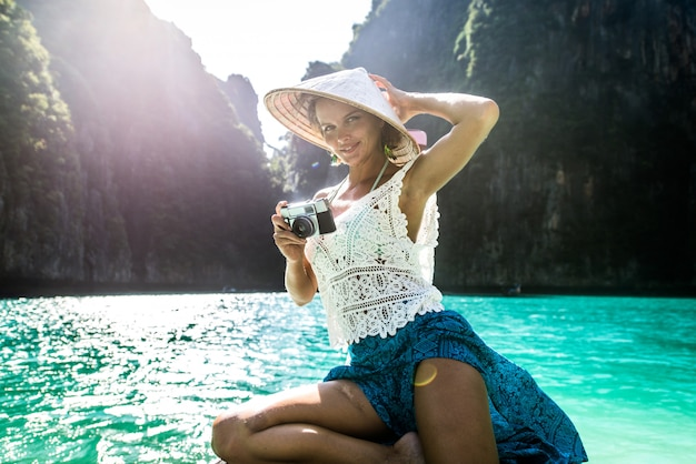 Beautiful woman on a long-tail boat in thailand