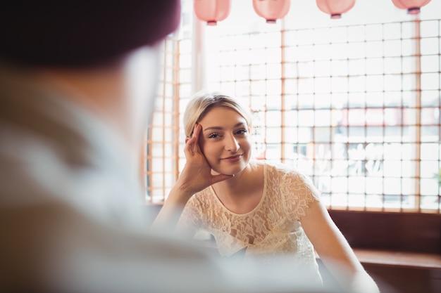 Beautiful woman looking at man