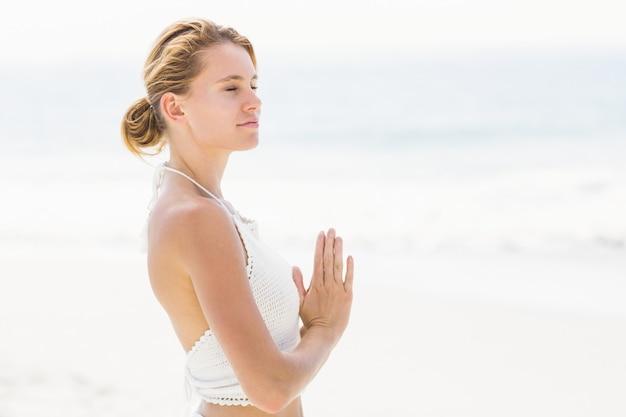 Beautiful woman in lotus position