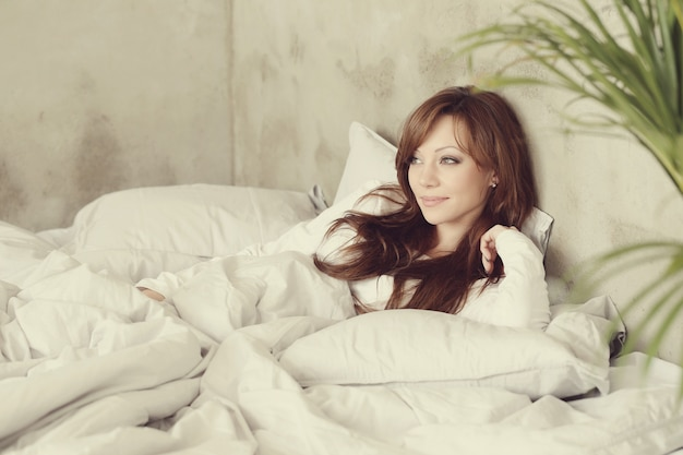 Beautiful woman lying in the bed