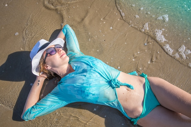 Beautiful woman lying on the shore
