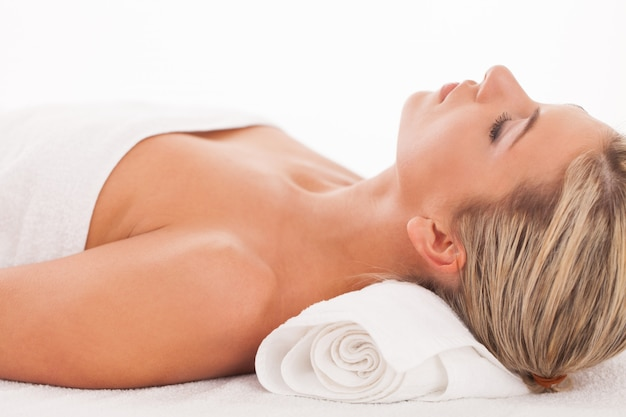 Beautiful woman lying in a spa