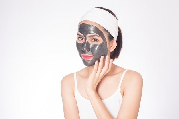 Beautiful woman masking her face on white background