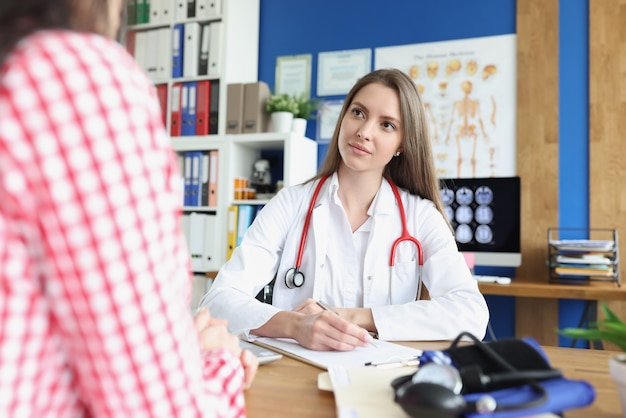 Beautiful woman medicine doctor communicates with patient