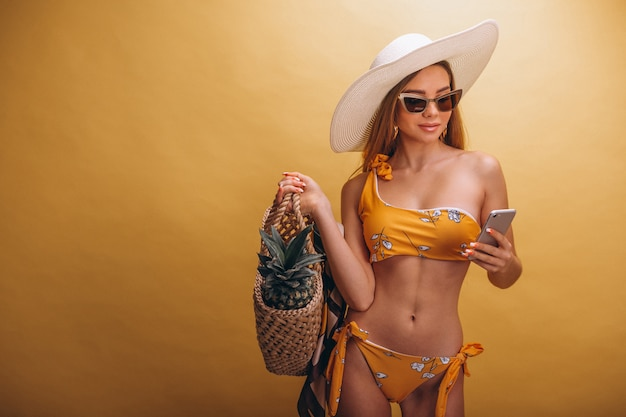 Beautiful woman model in swimminmg suit isolated
