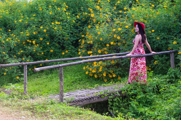 Beautiful woman in nature flower.
