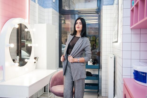 Beautiful woman near mirror interior