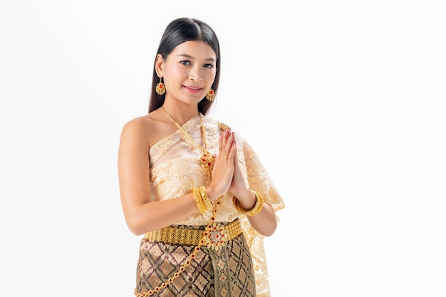 Beautiful woman pay respect in national traditional costume of thailand.
