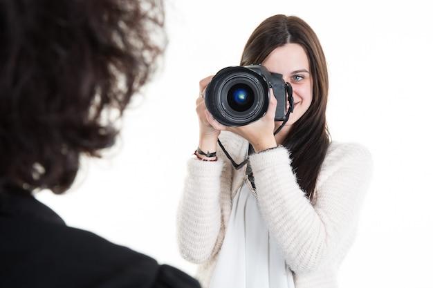 Beautiful woman photographer holding photo camera and take photos