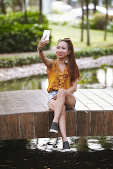 Beautiful woman photographing outdoors