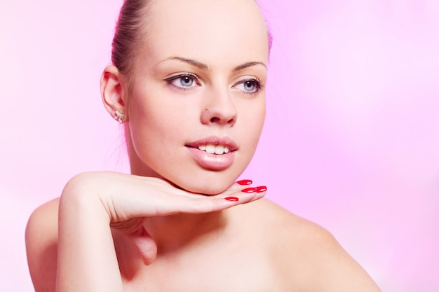 Beautiful woman over pink wall
