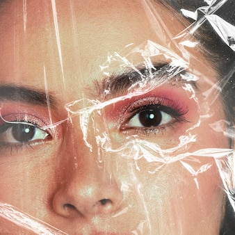 Beautiful woman behind a plastic wrap
