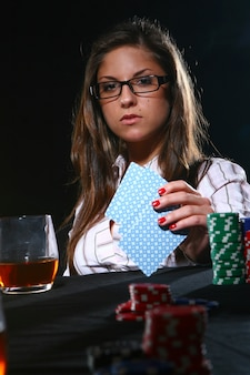 Beautiful woman playing poker