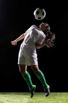 Beautiful woman playing with soccer ball