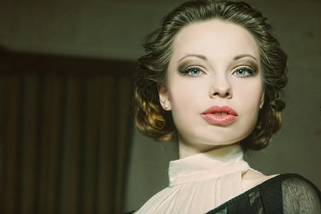 Beautiful woman portrait in classic interior. vintage processing