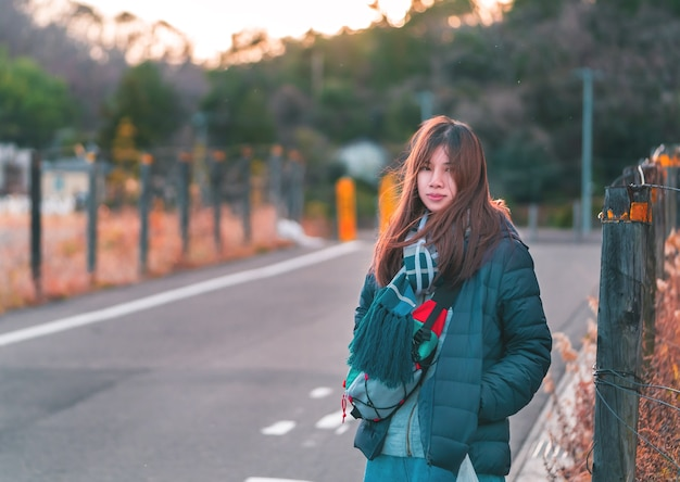Beautiful woman portrait in winter fashion clothing on the street in japan