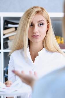 Beautiful woman portrait at workplace examining