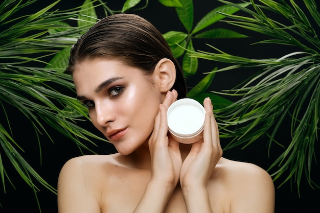 Beautiful woman posing for a body cream commercial