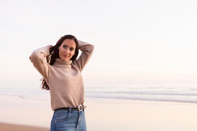 Beautiful woman posing by the beach with copy space