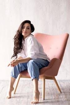 Beautiful woman posing on chair