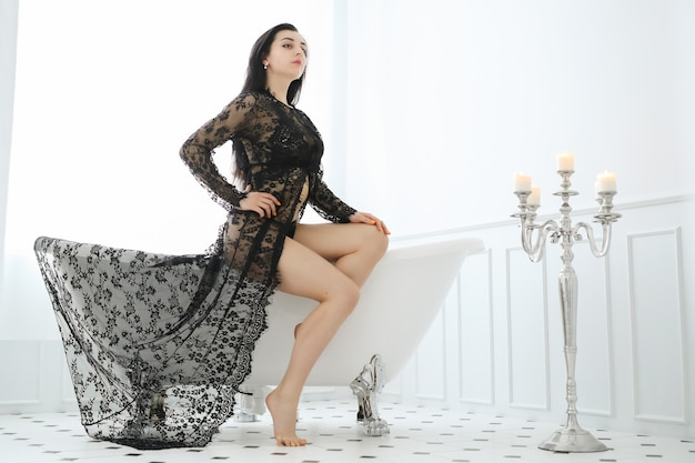 Beautiful woman posing at home in bathroom