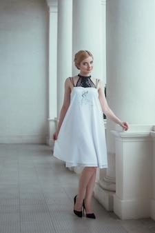 Beautiful woman posing long dress in livadia