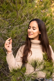 Beautiful woman posing in nature outdoors