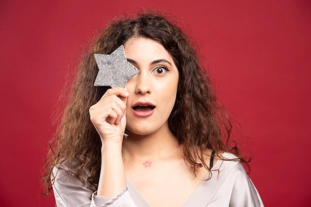 Beautiful woman posing with glittery star.