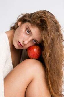 Beautiful woman posing with red apple