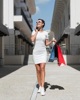 Beautiful woman posing with shopping bags