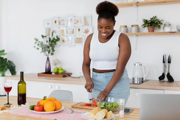 Beautiful woman preparing a romantic dinner