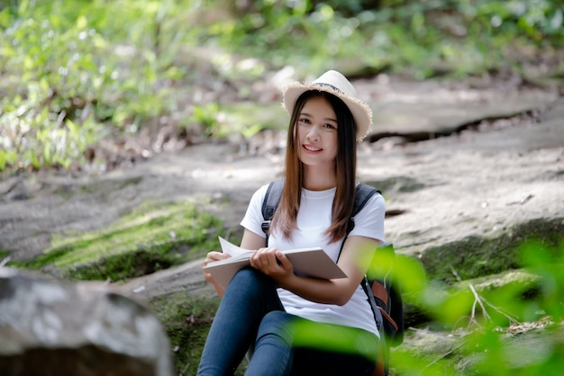 Beautiful woman reading book at nature