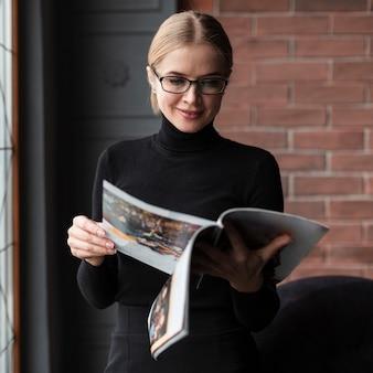 Beautiful woman reading magazine