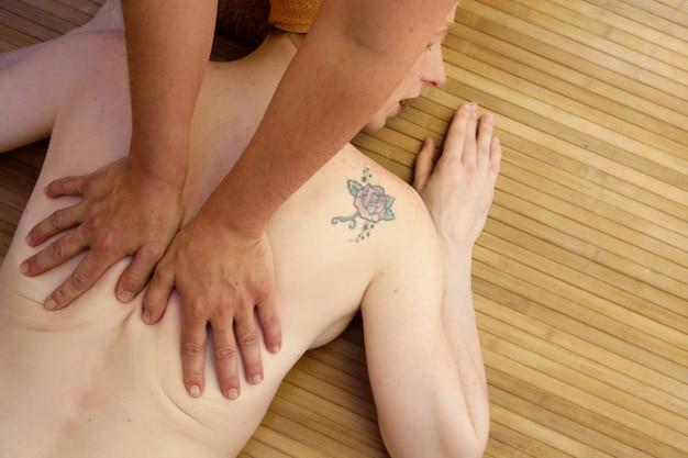 Beautiful woman receiving a back massage