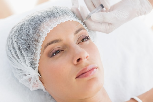 Beautiful woman receiving botox injection