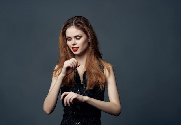 Beautiful woman red hair charm posing cosmetics dark background. high quality photo