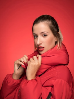 Beautiful woman in red jacket pose