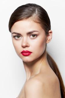 Beautiful woman red lips bared shoulders long hair