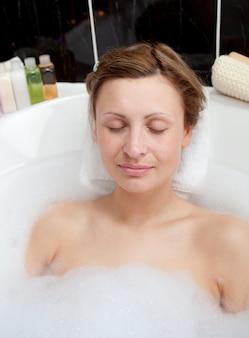 Beautiful woman relaxing in a bubble bath