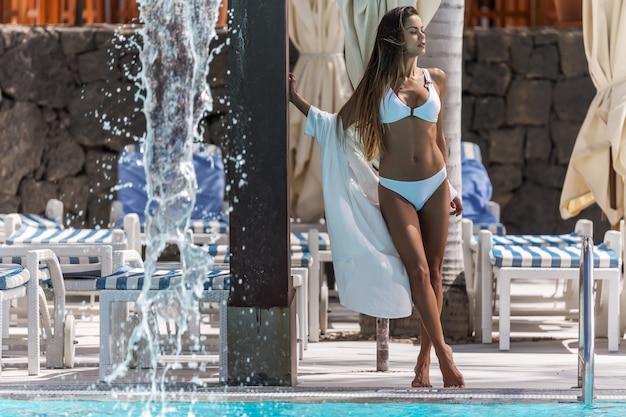 Beautiful woman relaxing on poolside