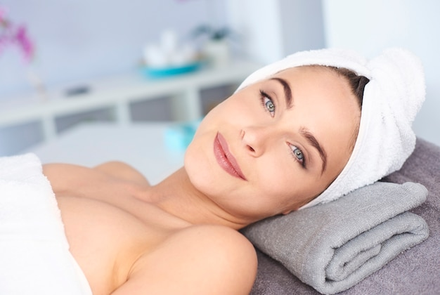 Beautiful woman relaxing in spa