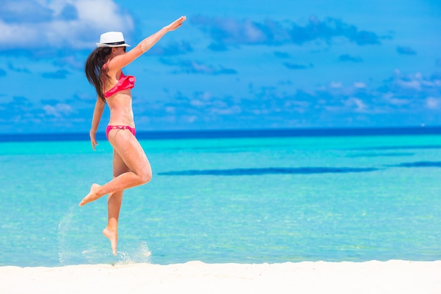 Beautiful woman relaxing at white sand tropical beach
