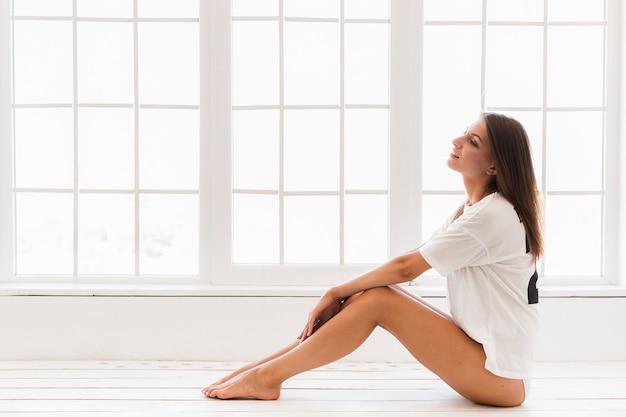 Beautiful woman resting near window