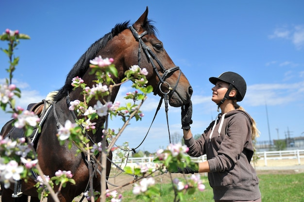Beautiful woman rider jockey having fun with her favorite horse