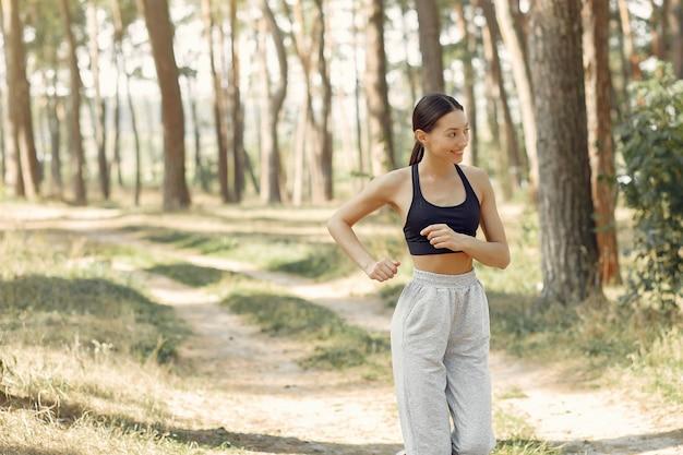 Beautiful woman runs in a summer park