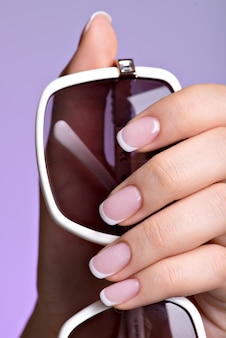 Beautiful woman's nails with beautiful french white manicure