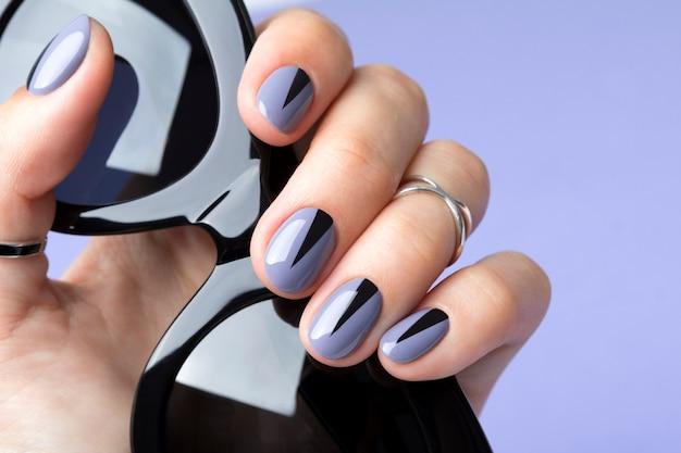 Beautiful woman's nails with geometric minimal manicure