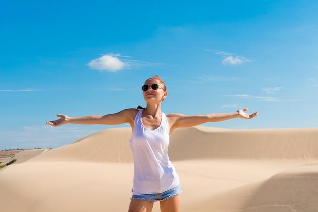 Beautiful woman in sand dunes