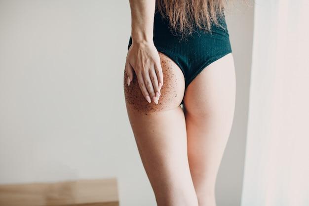 Beautiful woman scrubing her butt