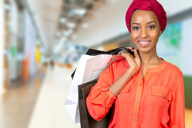 Beautiful woman shopping and holding bags